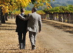 gay couple in vineyard